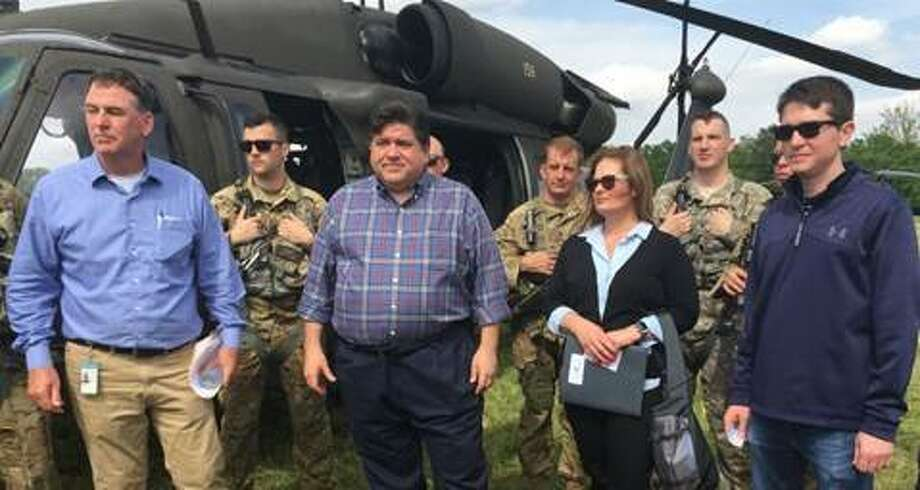 "Local and state leaders gather with members of the Illinois National Guard in Grafton, Illinois, to take a helicopter tour of Mississippi River floodwaters on June 4, 2019. Front row from left: John Sullivan, Gov. JB Pritzker, Sen. Rachelle Crowe (D-Glen Carbon), Sen. Steve McClure (R-Jacksonville). Back row from left: members of the Illinois National Guard. Photo courtesy of Illinois Senate Democrats. ""It was motivating to see each community come together to manage the rising flood waters,"" Crowe said. ""I wanted to commend the first responders and volunteers that are working tirelessly to protect their homes, businesses and citizens. IEMA has also done a tremendous job organizing their efforts with the National Guard to keep state resources available for those who are struggling."" Photo: Submitted Photo"