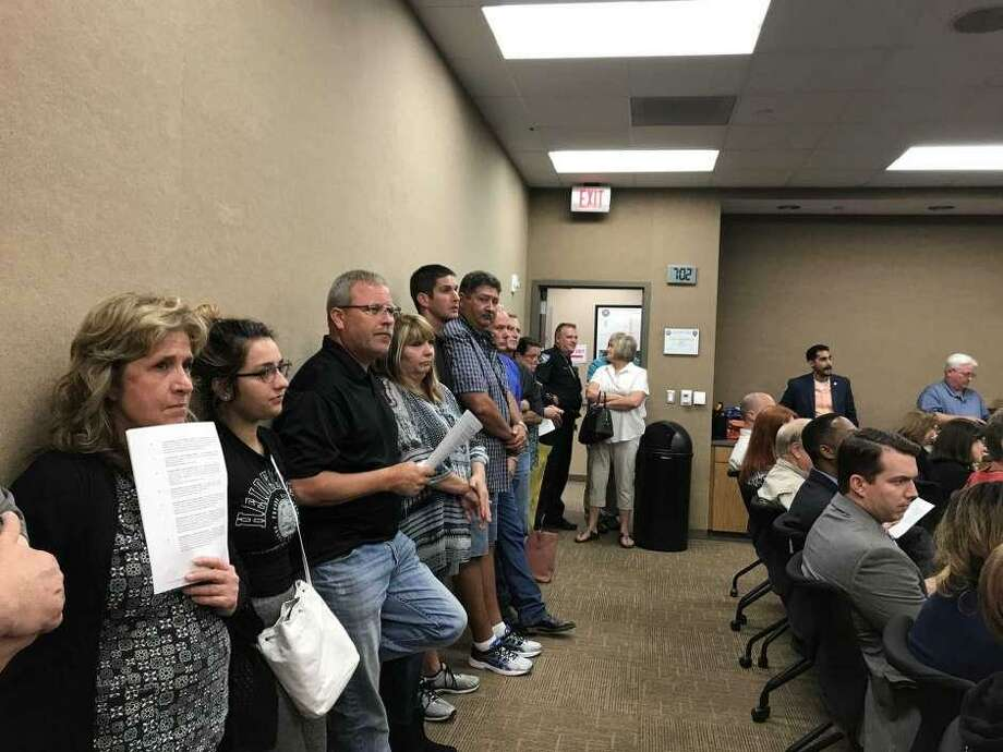 Residents attend a Pearland City Council meeting in 2018 where the city considered annexing some areas in its extraterritorial jurisdiction. After the city rescinded annexation of the areas, residents in some of those tracts approved creation of two taxing districts to fund emergency services, and the city recently agreed to contract with those districts.
