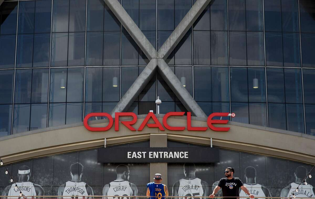 Fans wait outside the East Entrance before the Golden State Warriors face off against the Los Angeles Clippers in the first game of the NBA Playoffs at Oracle Arena in Oakland, Calif., Saturday, April 13, 2019.