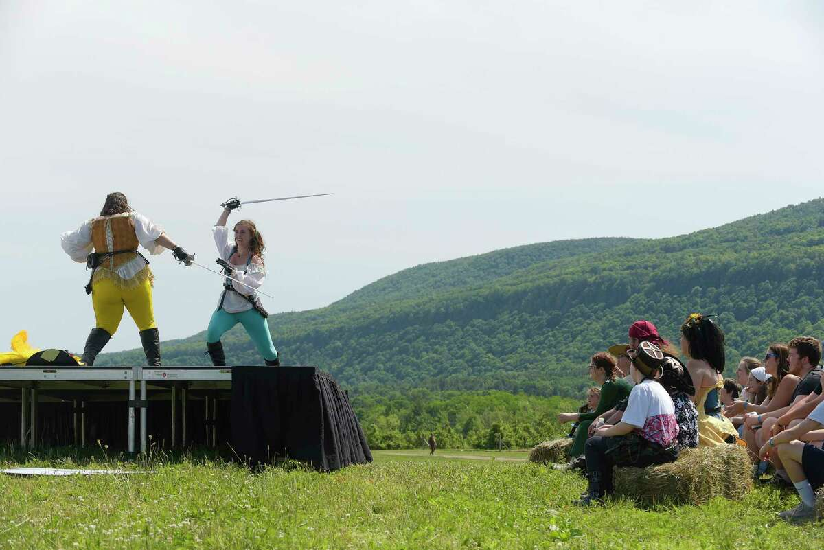 Women who make up the group, Vixens En Garde, perform on stage at the Capital Region Renaissance Festival at Indian Ladder Farms on Sunday, June 10, 2018, in Altamont, N.Y. The event, which is put on by Kendall Hudson Events, is held on Saturday and Sunday. This is the fifth year the festival has been held at Indian Ladder Farms, and the festival has grown in size each year. (Paul Buckowski/Times Union)