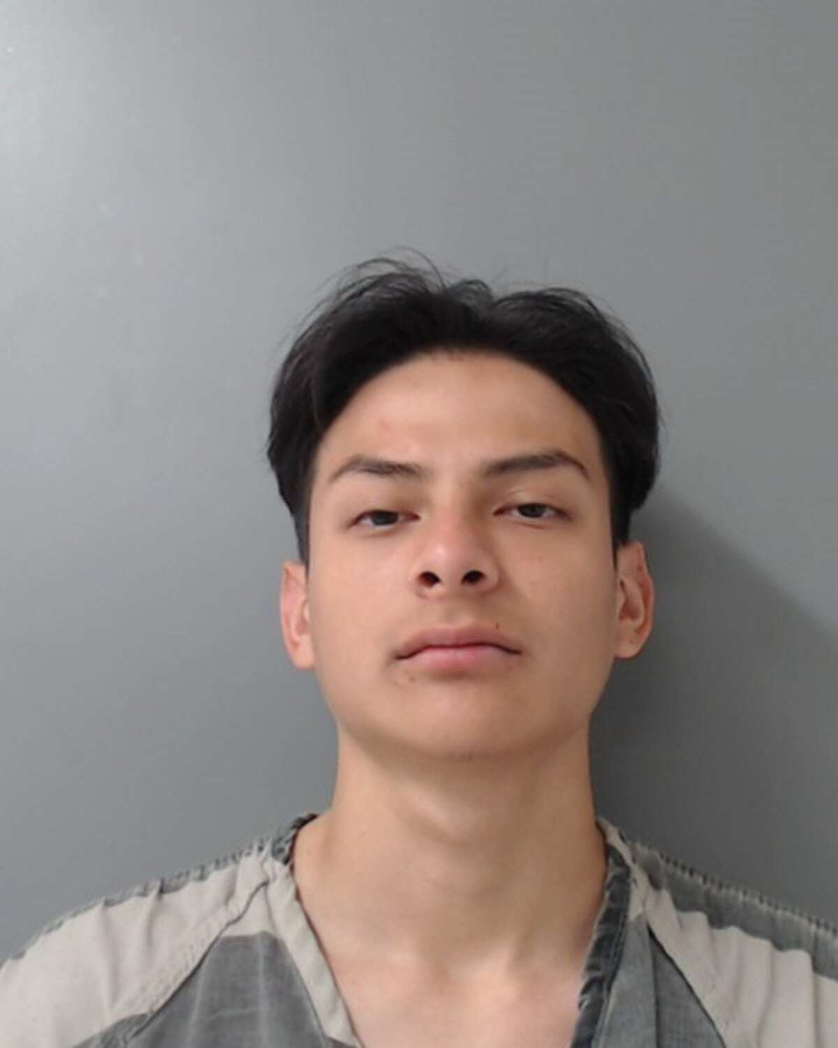 Luis Enrique Melo, 18, was charged with robbery and engaging in organized criminal activity.