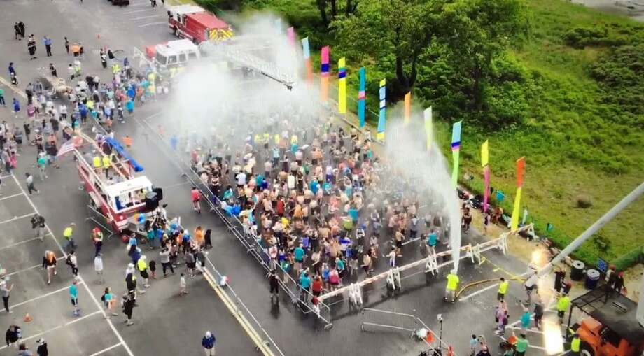 Drone footage from the Fairfield Fire Dept. showing the Fairfield Road Races' effort to break a Guinness World Record for most people showering simultaneously in one venue. Photo: Contributed Photo / Contributed Photo / New Canaan News contributed