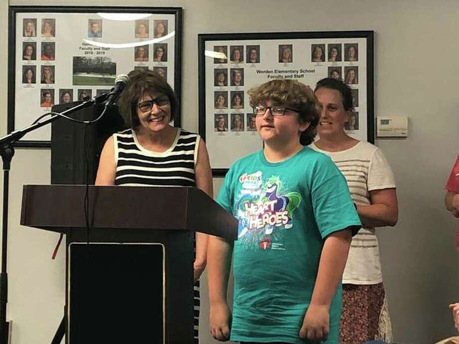 Renee Ades, youth market director with the American Heart Association, introduces Woodland Elementary School's Elijah Hynes who raised $510 alone during this year's Kids Heart Challenge. Photo: Julia Biggs | The Intelligencer