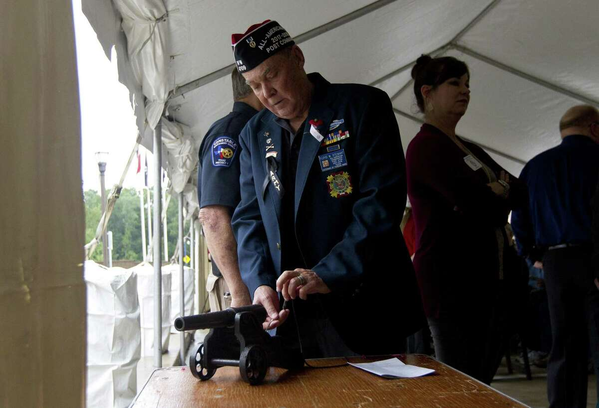 Floyd Stewart, commander of VFW Post 4709, prepares a small canon to fire during a D-Day observance ceremony and dedication of the Montgomery County Veterans Memorial Monument, Wednesday, June 5, 2019, in Conroe.