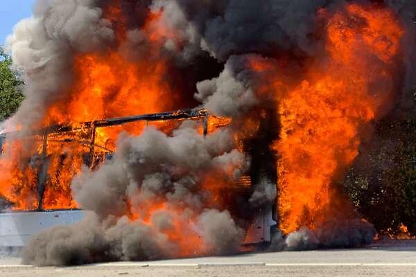Burning Apple bus on I-280 sparks grass fires near Portola Valley