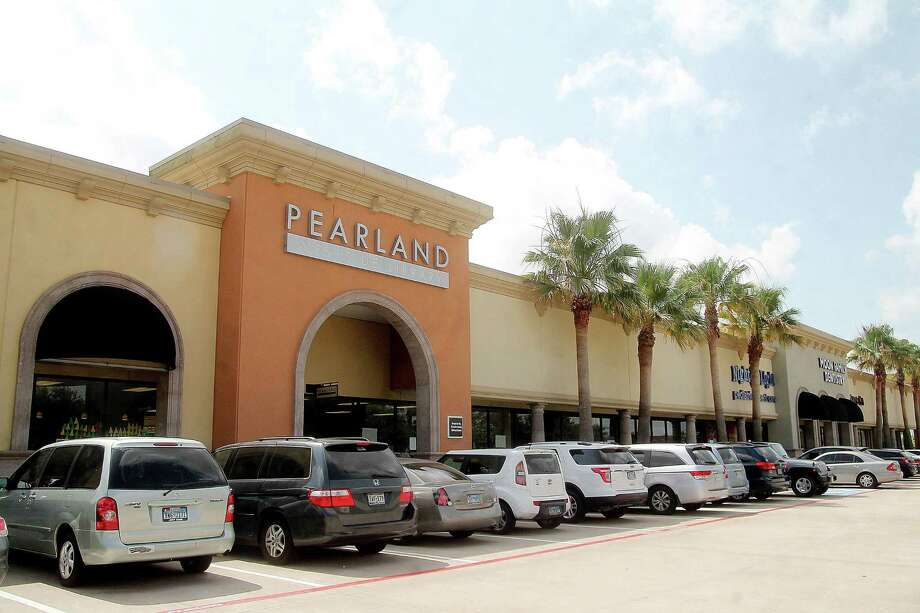 The city of Pearland plans to build a stand-alone Westside Library near Kirby Drive and Shadow Creek Parkway to replace this facility rented in a strip center on Business Center Drive. Photo: Pin Lim, Freelance / For The Chronicle / Copyright Pin Lim.