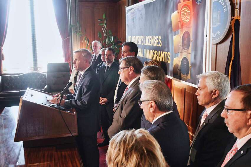 Senator Chris Jacobs, left, surrounded by his fellow Republicans, expresses his opposition to legislation that would provide illegal immigrants with New York driver's licenses during a press conference on Wednesday, June 5, 2019, in Albany, N.Y. (Paul Buckowski/Times Union)