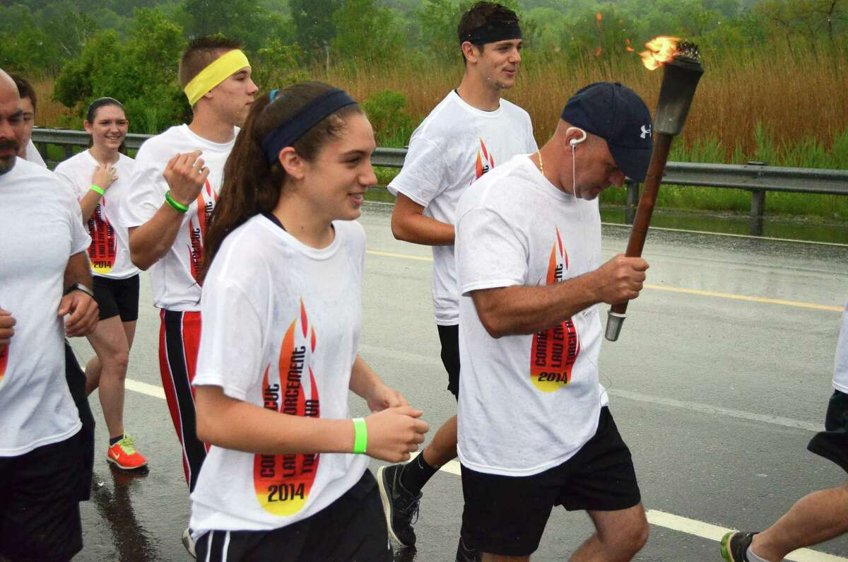 In this file photo, runners from Torrington carry the Special Olympics torch through the city from the Litchfield border to the Winchester border as part of a fundraiser effort for Special Olympics. Some of the runners were from Torrington High School and others were members of the Torrington Police Department. The Torrington leg of the trek was organized by the Torrington SRO Steven Cloutier.