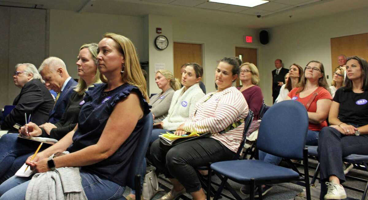 Over 50 parents attended a Board of Finance meeting June 4 that saw the board approve funding for a 441-student Mill Hill School.