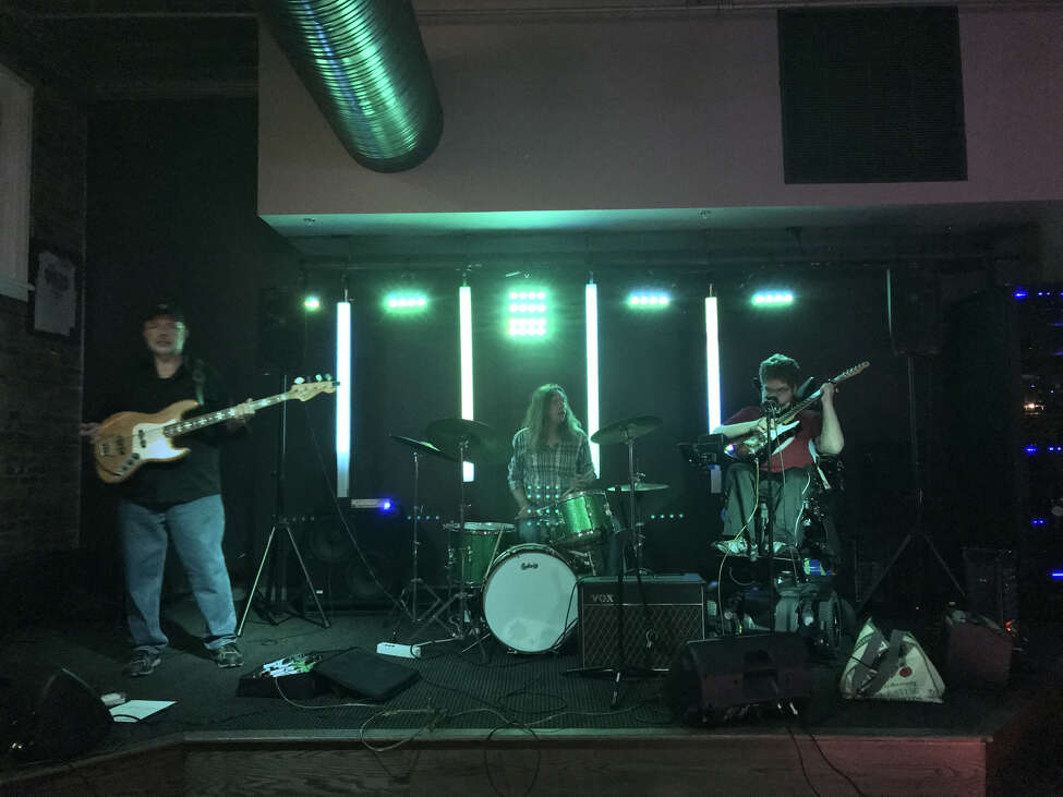Lucas Garrett, right, performing with bassist Kevin Kosach and drummer William O'Donovan.