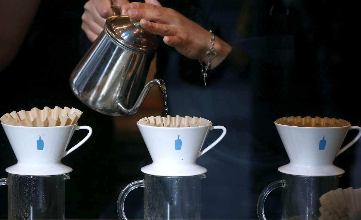 Barista Yana Powers pours water for drip coffee at Blue Bottle Coffee at Market and 10th streets in San Francisco, Calif. on Thursday, Feb. 28, 2019. The cafe inside the Twitter headquarters building is one of a handful of Blue Bottle stores that will go cashless for a trial period beginning March 11.