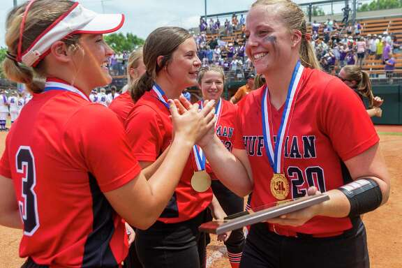 Huffman Hargrave pitcher Katy Janes (20) celebrates her MVP award with Tiegan Boyd (3) after a 12-0 win in six innings over Anna during the UIL Class 4A state softball championship in Austin, Saturday, June 1, 2019. (Stephen Spillman / for Houston Chronicle)