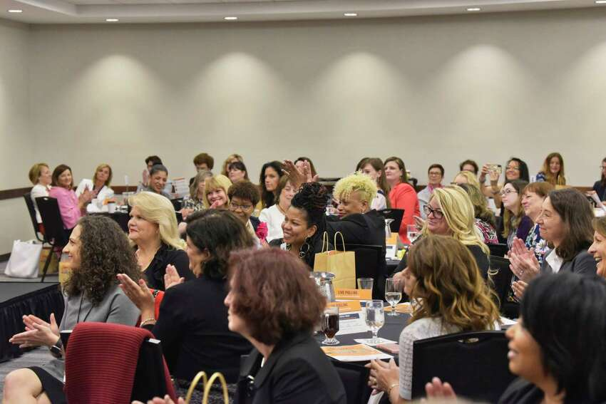 Women listen as Lisa Burton, executive director of HearstLab, delivers the keynote address at the Women@Work 3rd annual Summit at the Hearst Media Center on Wednesday, June 5, 2019, in Colonie, N.Y. (Paul Buckowski/Times Union)