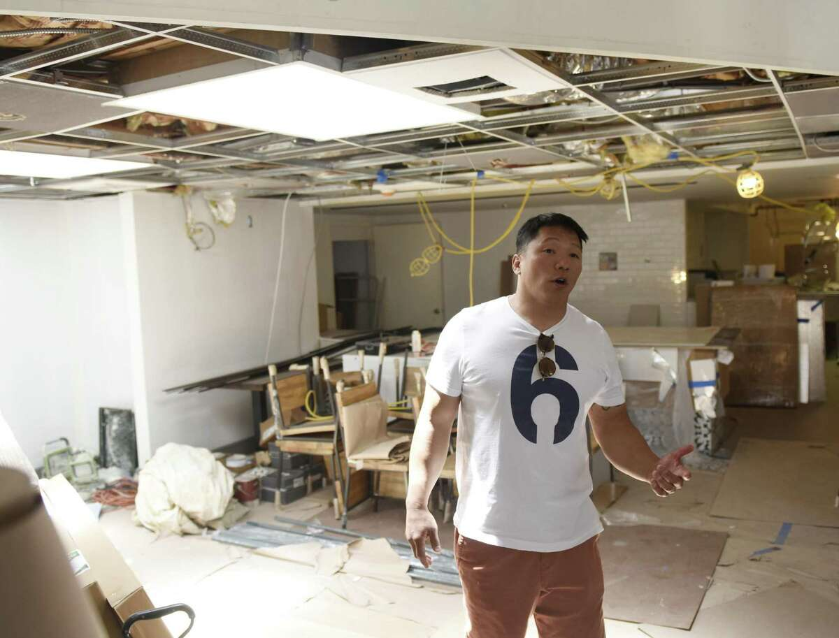 Owner and chef Dennis Lake shows the interior, under construction, of La Taqueria, at 10 Greenwich Ave., in Greenwich, Conn., on Monday, June 3, 2019.