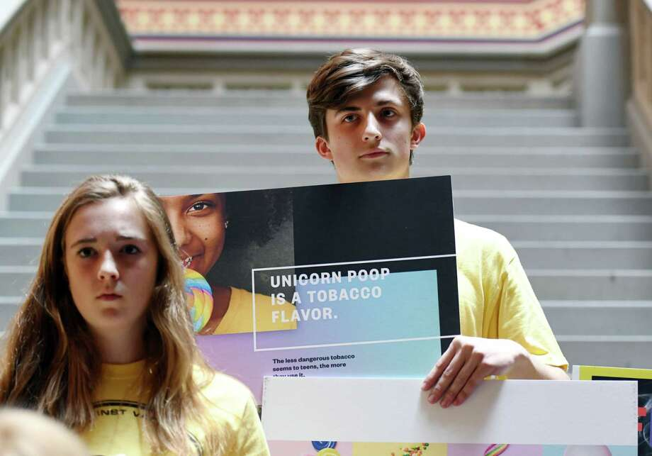 Spencer Schultz, 19, holds up an anti-vaping poster during a demonstration calling for the passage of a bill banning flavored e-cigarettes on Wednesday, June 5, 2019 at the Capitol in Albany, NY. (Phoebe Sheehan/Times Union) Photo: Phoebe Sheehan, Albany Times Union / 40047146A