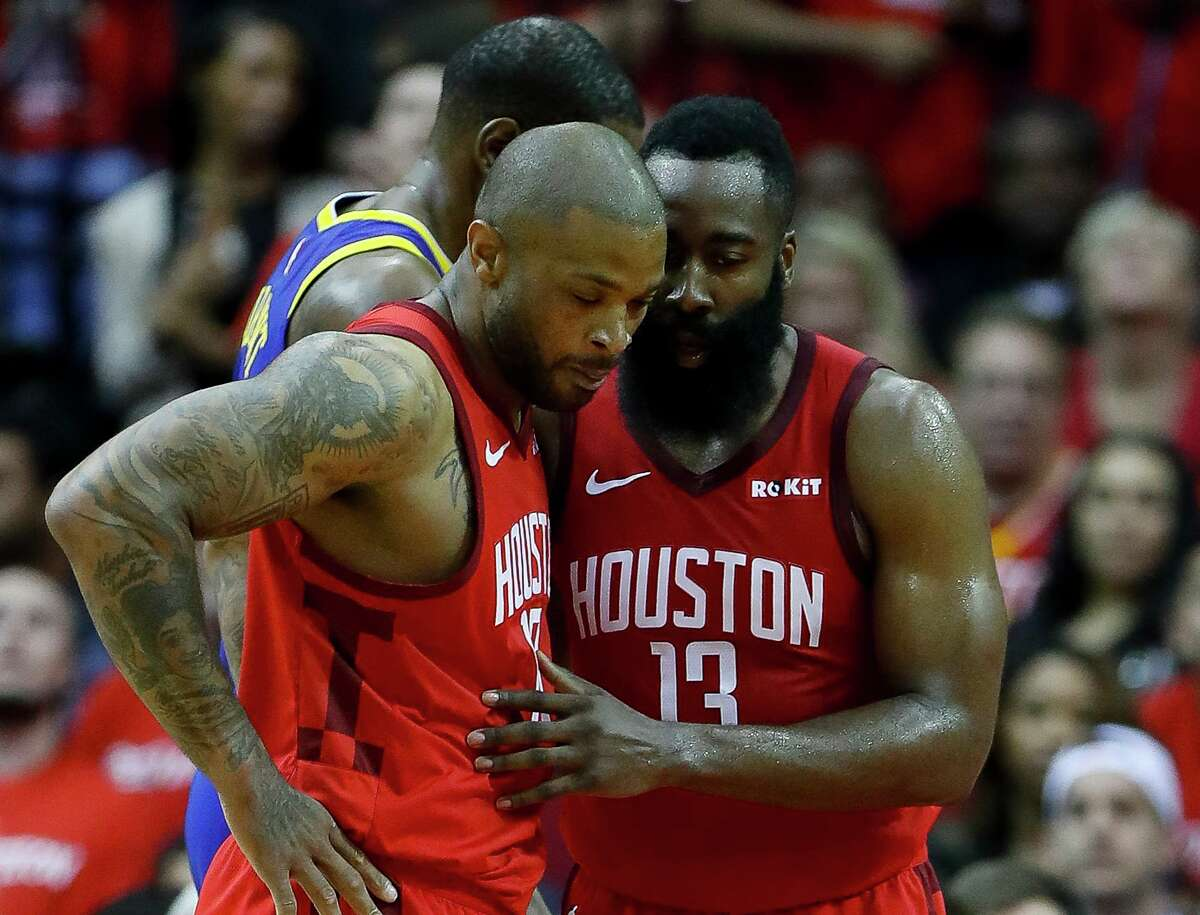 Forward P.J. Tucker, left, and guard James Harden practiced with the Rockets for the first time this season Monday.