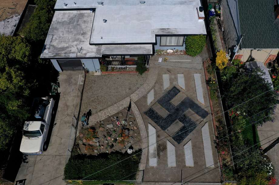 The swastika in the front yard of the Steve Johnson home in El Sobrante as seen from the air.People living in the San Francisco Bay Area suburb are upset that Johnson landscaped his front yard to resemble symbol associated with the Nazi regime. (June 5, 2019.) Photo: Justin Sullivan/Getty Images / 2019 Getty Images