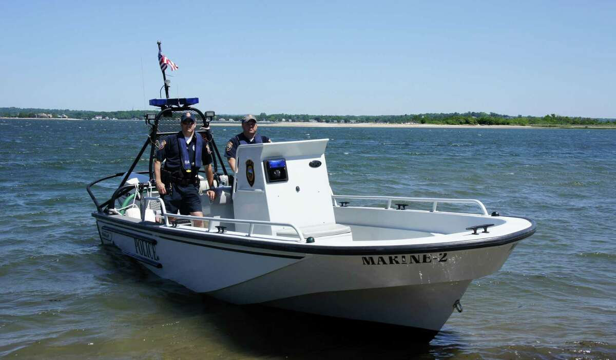 Westport police officers in the department's Marine Division patrol Cockenoe Island in a Boston Whaler boat. - File photo