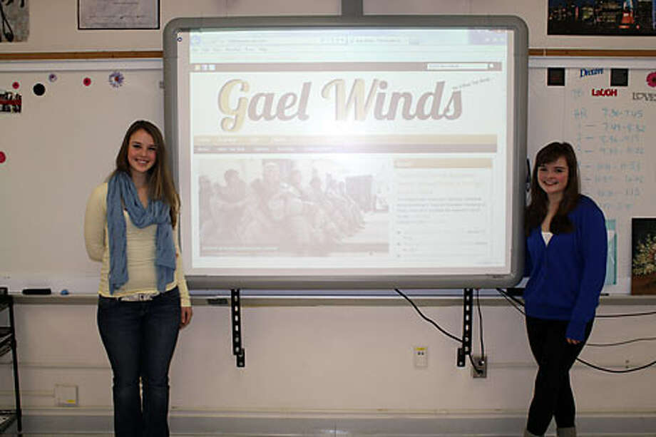 Gael Winds editors Kristen Grabarz and Colette Harley show off the new website. — Lynn Coffin photo