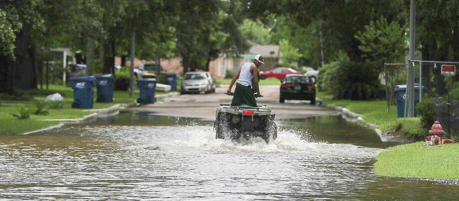 An ATV was used to enter a flooded neighborhood  Wednesday, June 5, 2019, in Kendleton. Photo: Steve Gonzales, Staff Photographer / © 2019 Houston Chronicle