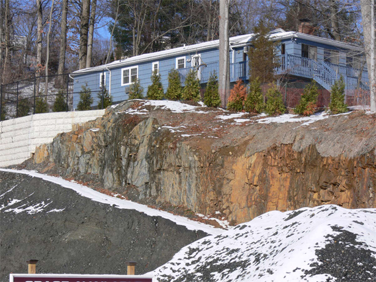 Excavation work on the retail development project at 781-785 River Road has been controversial because of how close the ledge drop-off is to a house and yard on Turner Road.