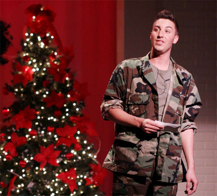 "Shelton resident Casey Blohm sings ""I'll Be Home for Christmas"" in the Center Stage Theatre's holiday show."