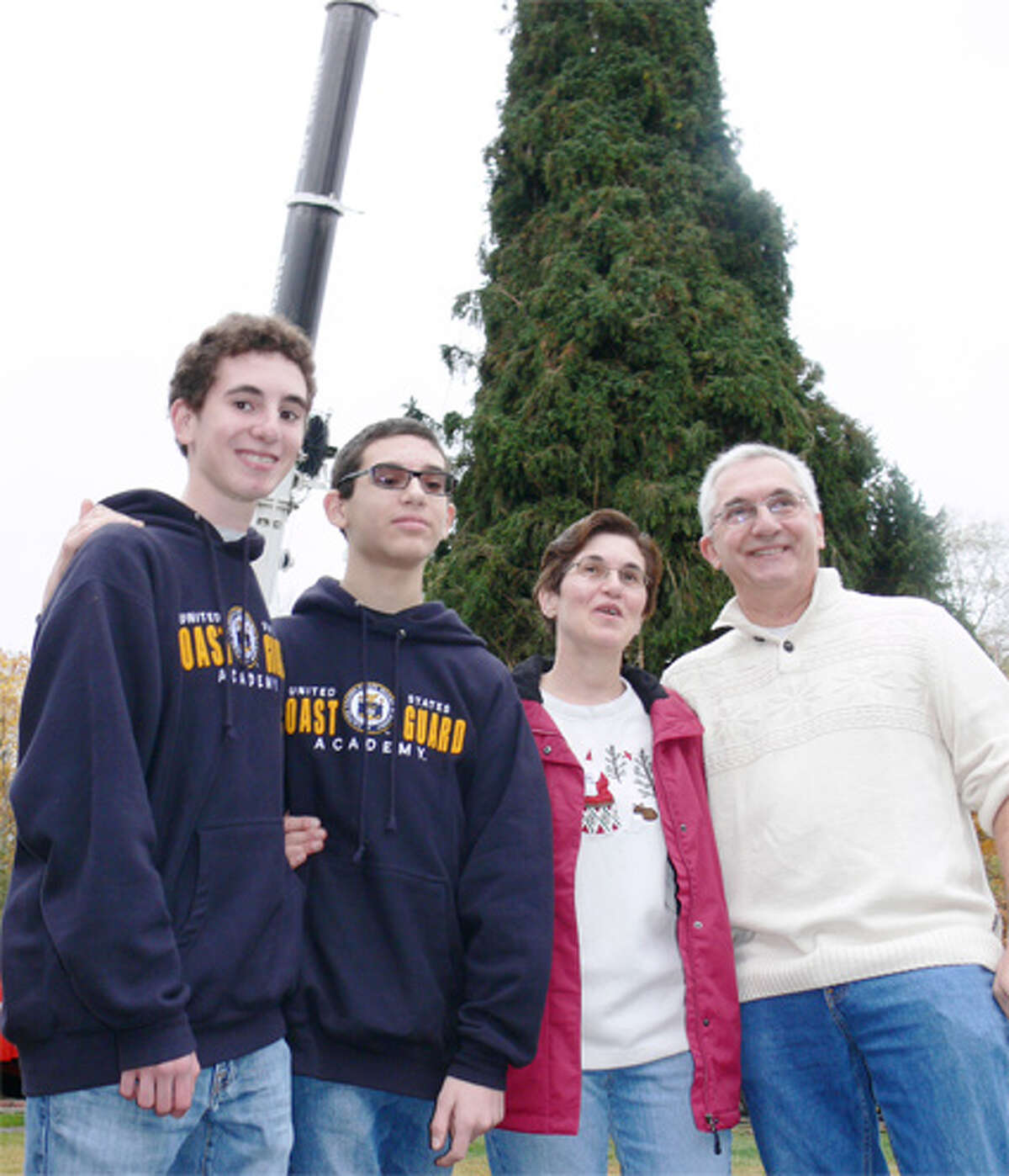 The Vargoshe family of Shelton in front of the tree when it was still in their yard. From left are son Nathan, son Noah, mom Louise and dad John.