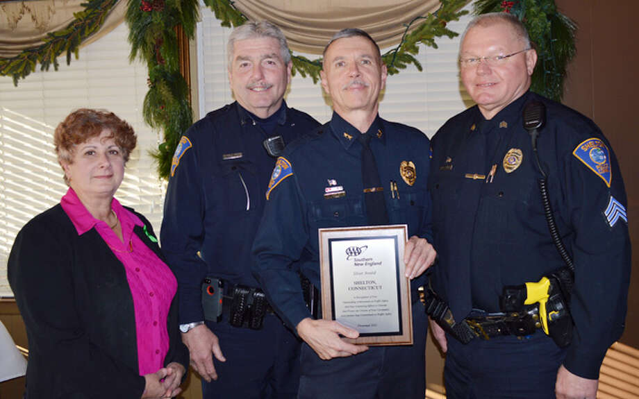 From left, local AAA Public Affairs Manager Fran Mayko presents the SIlver Award to, from left, the Shelton Police Department's officer Mark Siglinger, Chief Joel Hurliman and Sgt. Pete Zaksewicz. Siglinger and Zaksewicz are certified AAA driving improvement program instructors.