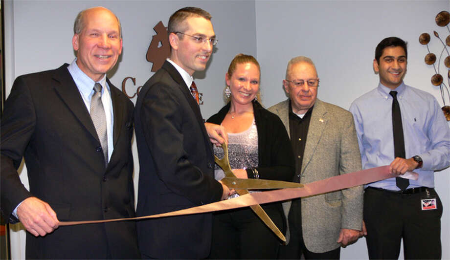 At the ribbon-cutting ceremony for the new office of Concierge Tax Services in Shelton are, from left, Greater Valley Chamber of Commerce President Bill Purcell, Concierge Tax Services owner Robert Gambardella, Robert's wife Jennifer, Board of Aldermen President John Anglace, and the company's Hersh Parikh.