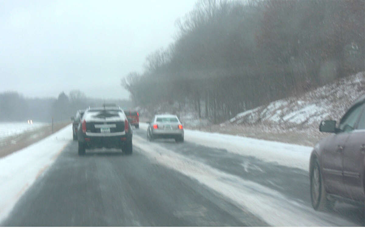 Cars travel on Route 8 in Shelton at about 8:15 a.m. on Saturday, when the snowstorm was just starting.