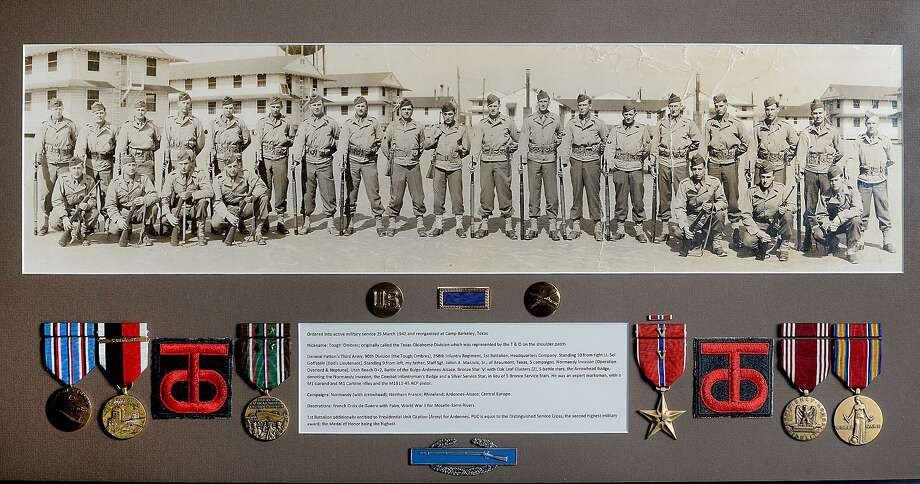 """A photo showing Jerry Mazzola's father, Julian A. Mazzola, Sr., with members of the 358th Infantry 90th Division, a Texas - Oklahoma Division that was known by the nickname """"Tough 'Ombres,"""" at Camp Barkeley in Texas. Mazzola entered France with his unit two days after D-Day, making his way through the country to Germany. Photo taken Tuesday, June 4, 2019 Kim Brent/The Enterprise Photo: Kim Brent / The Enterprise / BEN"""