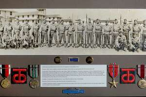 """A photo showing Jerry Mazzola's father, Julian A. Mazzola, Sr., with members of the 358th Infantry 90th Division, a Texas - Oklahoma Division that was known by the nickname """"Tough 'Ombres,"""" at Camp Barkeley in Texas. Mazzola entered France with his unit two days after D-Day, making his way through the country to Germany. Photo taken Tuesday, June 4, 2019 Kim Brent/The Enterprise"""