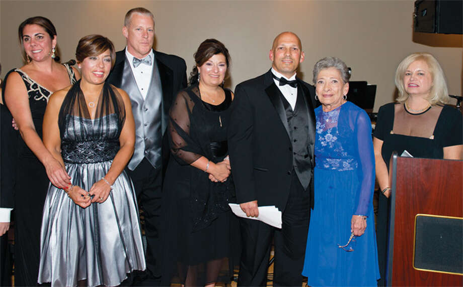 The DiMatteo family was honored at the Kennedy Center's 49th annual Four Seasons Ball for their support of local charities, including the Kennedy Center. Shown at the ball, from left, are Kim DiMatteo of Bethany; Loretta and Rob Lesko and Rose Esposito, all of Shelton; John DiMatteo of Bethany, and Adeline DiMatteo of Shelton. On the far right is Cara Mocarski of Shelton, Tribute Journal chairman.