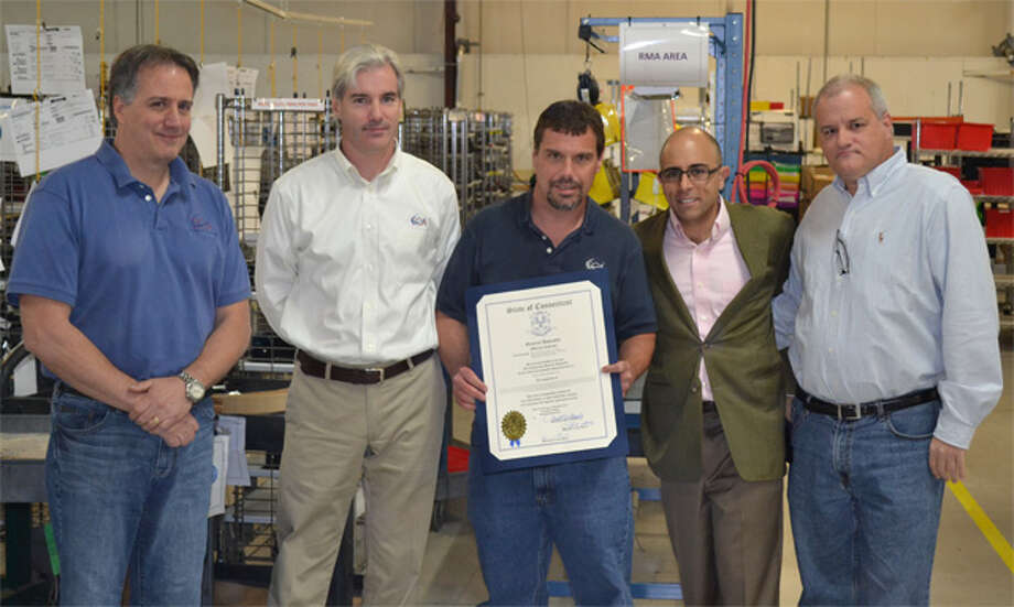 State Rep. Jason Perillo, second from right, congratulates officials from Electri-Cable Assemblies at the company's Shelton facility.