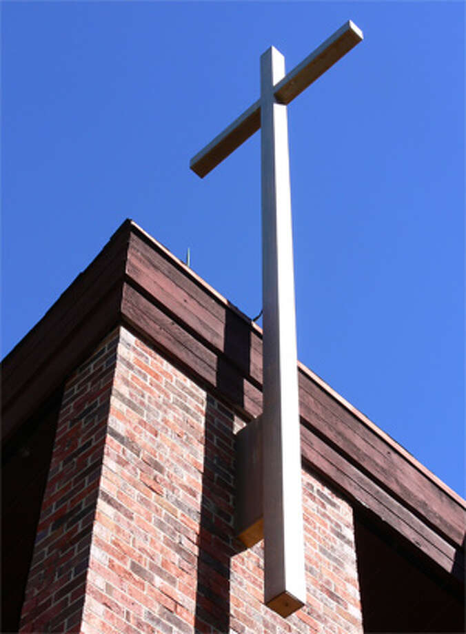 The cross on top of St. Margaret Mary Church in Shelton.