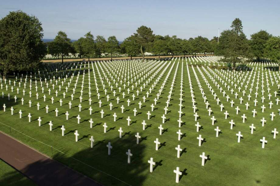 At the cemetery in Normandy, thousands of gravesites attest to the cost of war. Today, many of the scourges that produced D-Day — anti-Semitism, right-wing autocrats, power rivalries, arms races and naked aggression — enjoy new life. Photo: David Vincent / Associated Press / Copyright 2019 The Associated Press. All rights reserved