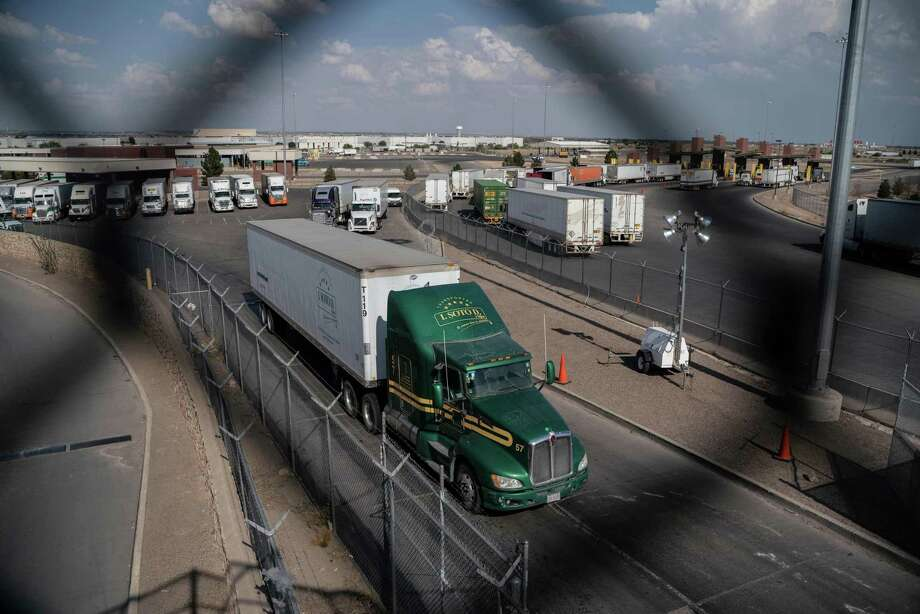 Semi-trucks cross the border May 31 at the Zaragoza International Bridge, in Juarez, Mexico, across the border from El Paso, Texas. The threat of tariffs on Mexican goods could increase all those indicators pointing to economic downturn in the United States. Photo: PAUL RATJE /AFP /Getty Images / AFP or licensors