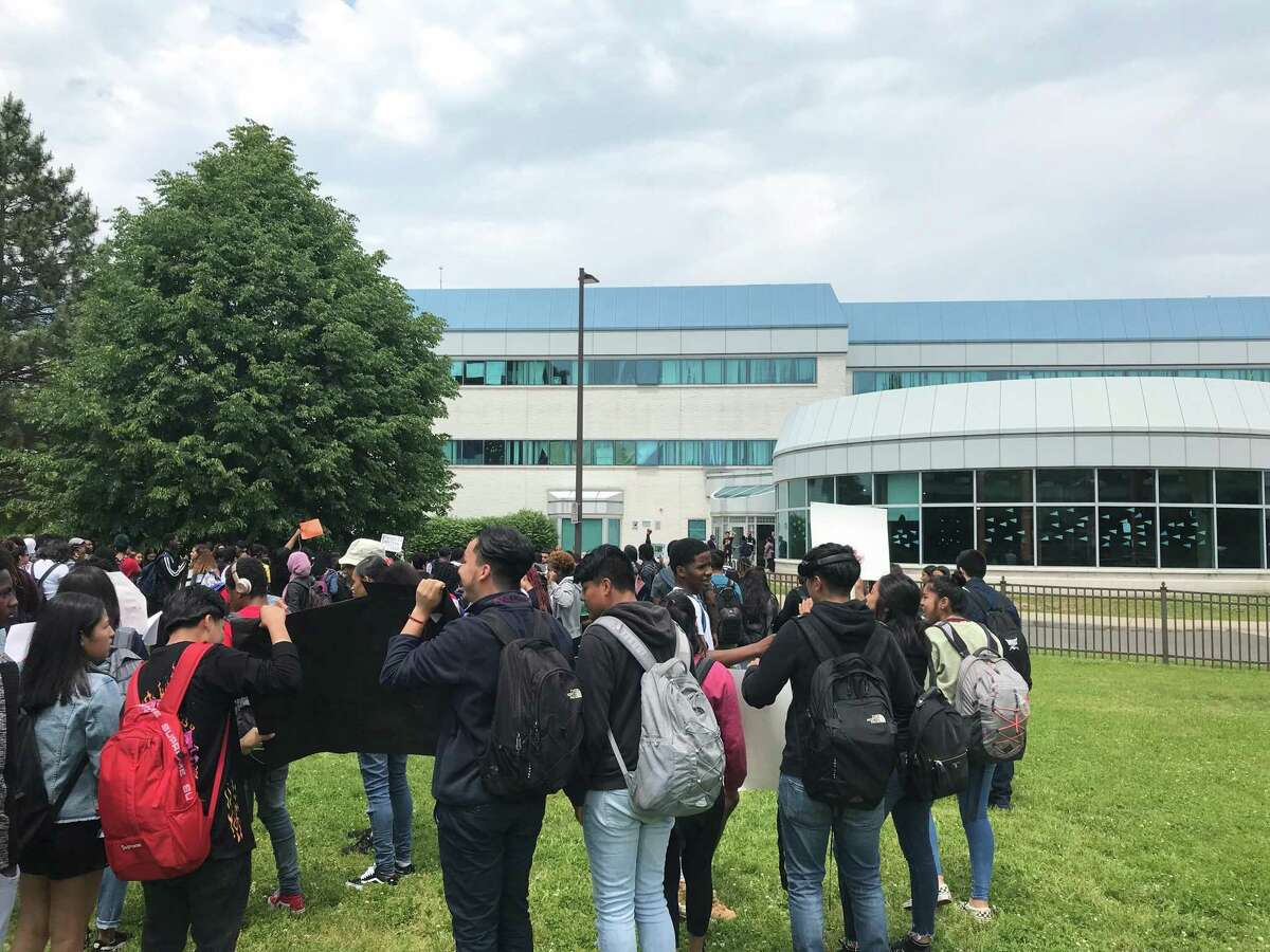 Students at Hill Regional Career High School filed out of school on June 5, 2019, to protest the decision to transfer beloved teachers out of the school as part of district-wide budget cuts.