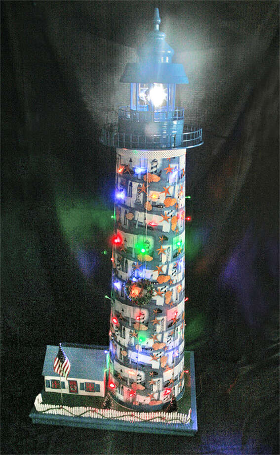 """Holiday Cove"" by Charlie Kestler of Shelton is one of the homemade lighthouses entered in the Festival of Lighthouses Contest at the Maritime Aquarium at Norwalk."