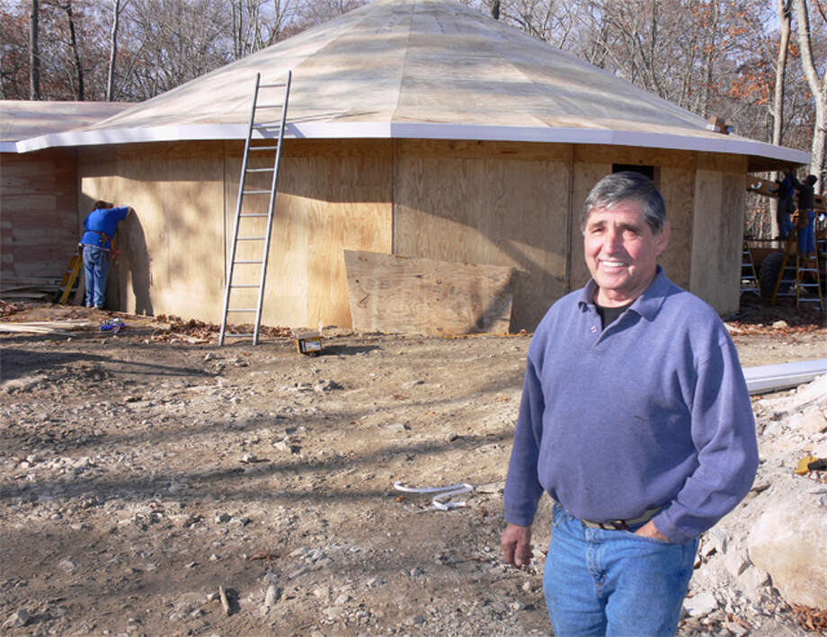 "Shelton contractor Yvon Rodrigue is building a round house for a client on Nells Rock Road. ""It will be very unique around here,"" he said of the structure's shape."