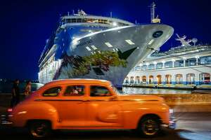 An old American car passes in front of a cruise docked at Havana's Harbour, on June 5, 2019. - The Trump administration clamped down on US tourist visits to Cuba on June 4, aiming to cut the flow of dollars to a country that Washington accuses of helping prop up Venezuelan President Nicolas Maduro. The Treasury Department banned group educational travel, cruise ship and private yacht visits by Americans, taking aim at the most common ways US tourists and Cuban-Americans visit the Caribbean island. (Photo by Adalberto ROQUE / AFP)ADALBERTO ROQUE/AFP/Getty Images