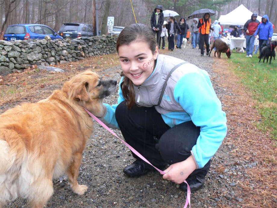 Jackie Turiano poses with organizer Valerie Mingrone's dog Jenny at the start of the walk Sunday that raised money to help get a diabetic alert dog for Jackie.