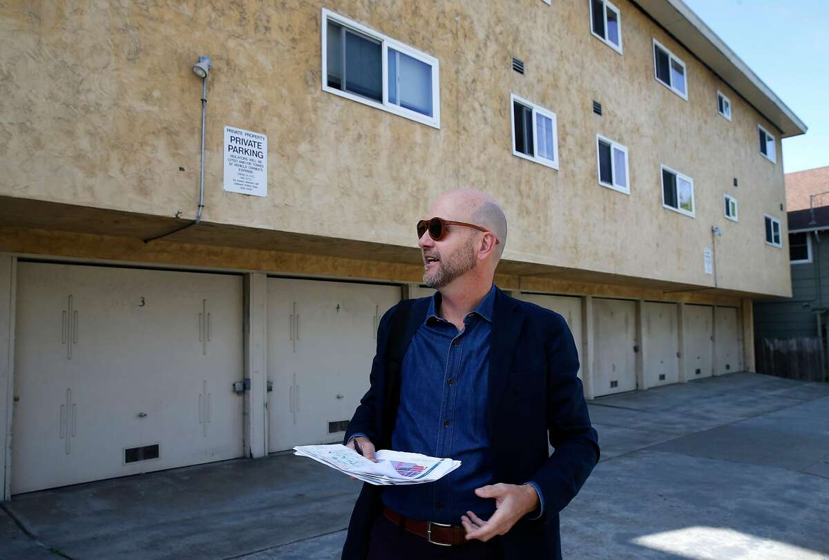 Architect and urban planner Daniel Parolek visits the backside of an apartment building on 62nd Street during a walking tour to view multi-unit dwellings in the Rockridge and Fairview Park neighborhoods of Oakland, Calif. on Wednesday, May 1, 2019.