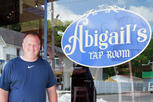 Brad Hagen stands outside of his new restaurant, Abigail's, at 217 Main St., Grafton. The restaurant opened Friday during what has become the second highest flood in history for the region. Hagen also owns the Grafton Oyster Bar, currently closed due to high water.