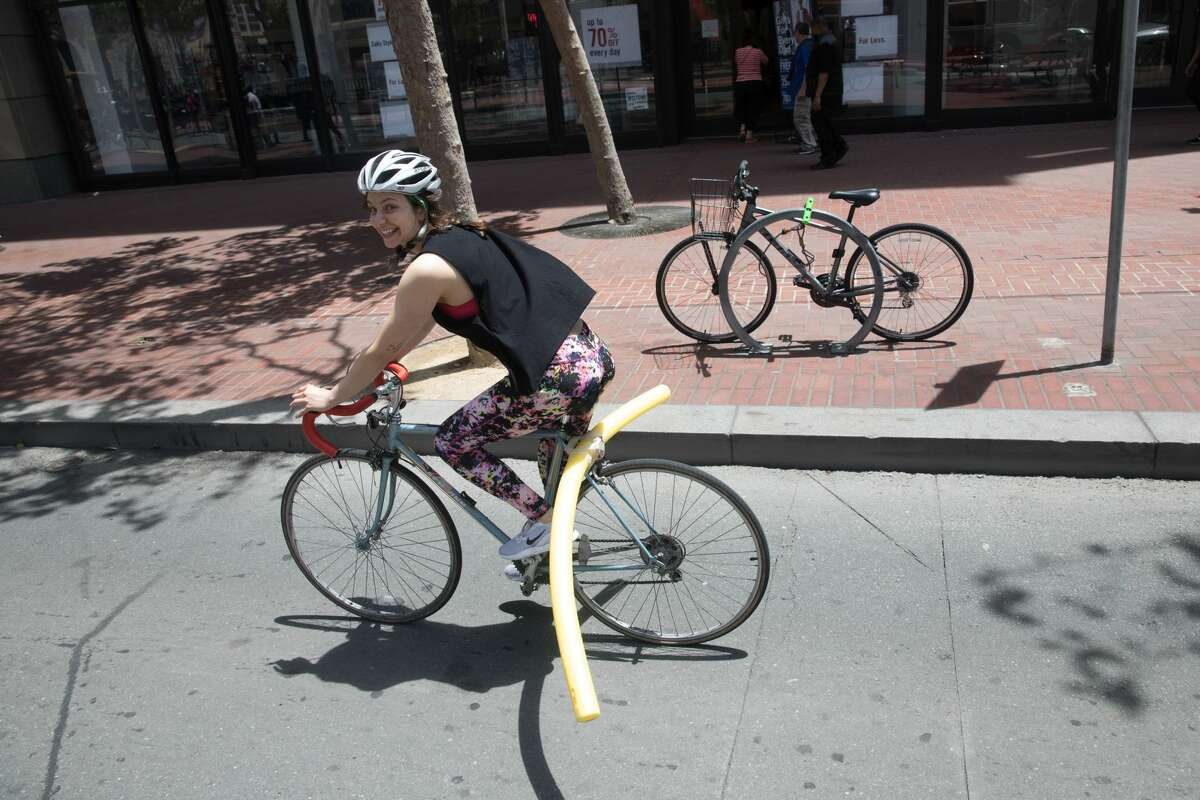 SFGATE Producer Michelle Robertson attached a pool noodle to her bicycle to see how difficult it would be to ride with one in San Francisco.