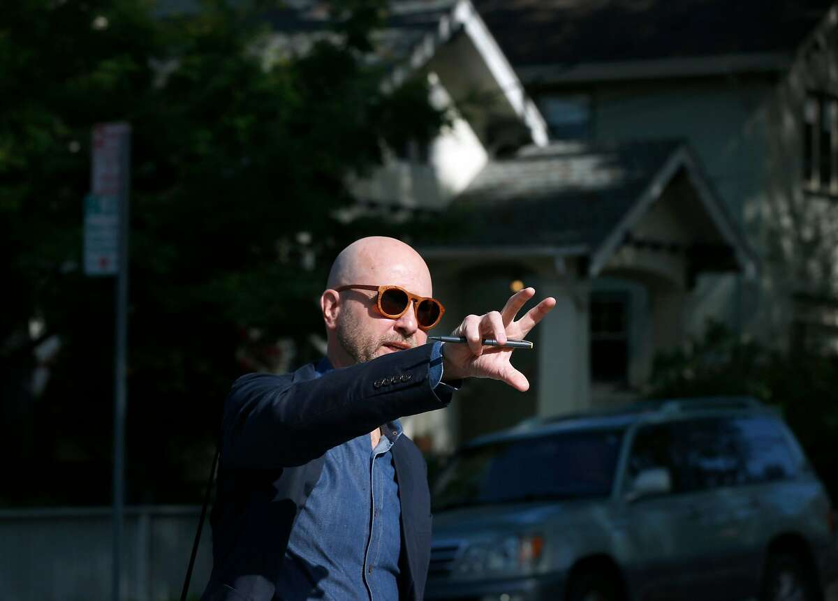 Architect and urban planner Daniel Parolek takes a walking tour to view multi-unit dwellings in the Rockridge and Fairview Park neighborhoods of Oakland, Calif. on Wednesday, May 1, 2019.