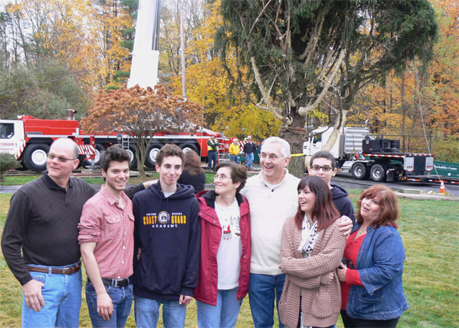 Extended members of the Vargoshe family pose in front of the tree just before it was cut down.