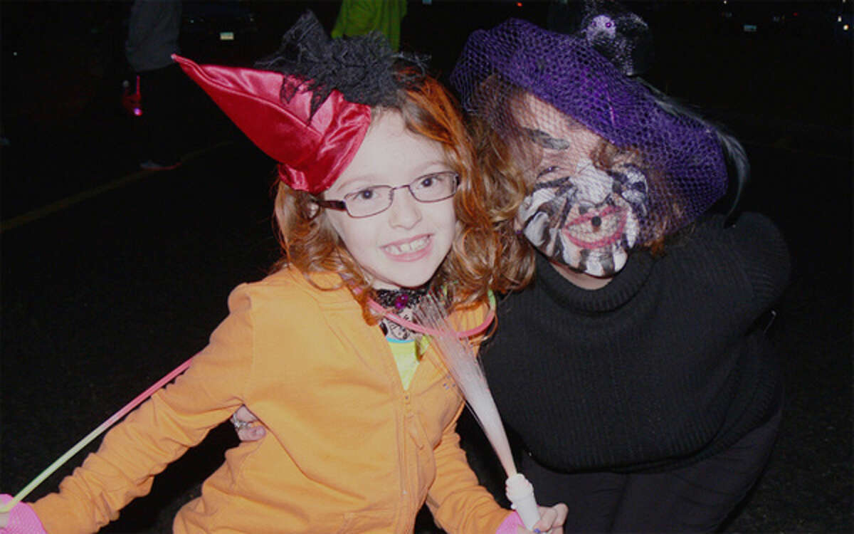 Bailey Pierce, 7, left, as a devo witch and her mom Brenda as a scary spider at the 2013 Trick or Trunk event in Shelton.