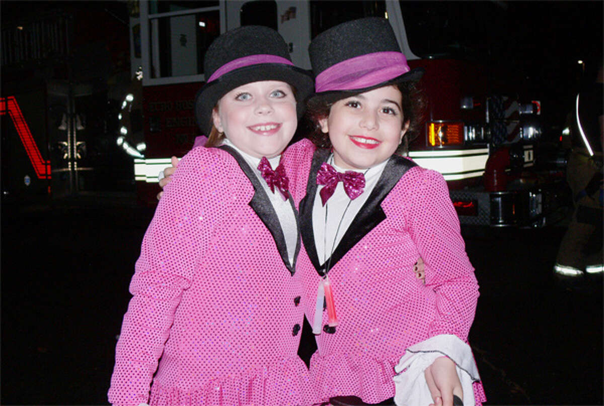 Rockettes Natalya Correria, left, and Hannah Weiss, both 9, prepare for their future Radio City Musical Hall debut in front of a Shelton fire truck.