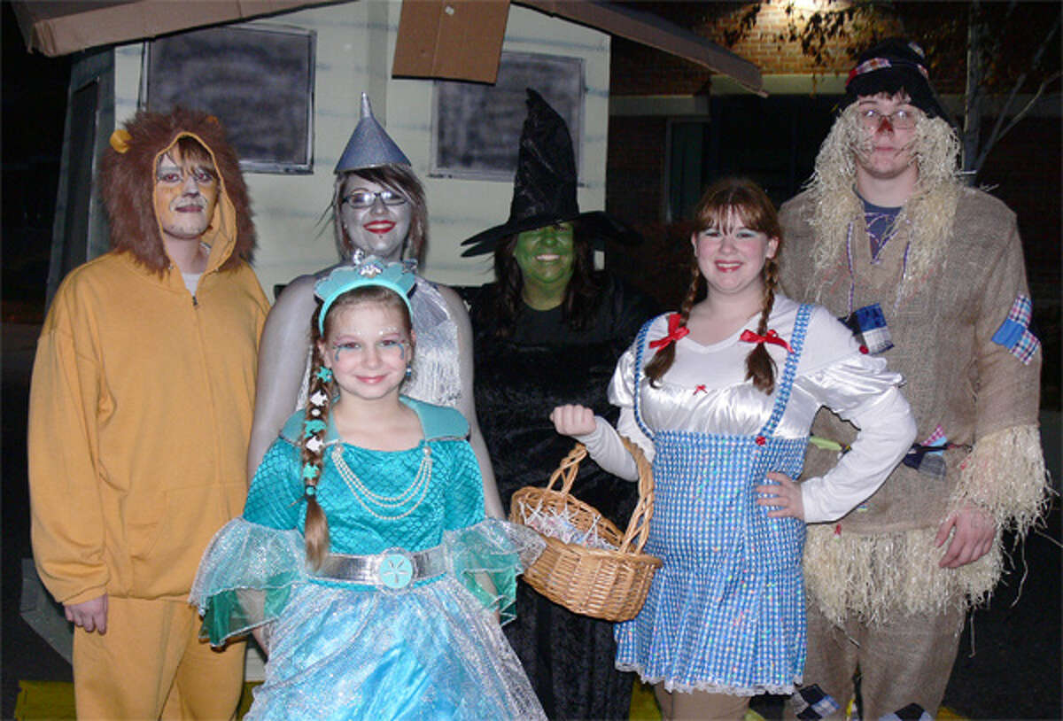 One decorated vehicle at the Shelton trick-or-trunk had a Wizard of Oz theme, with, from left, Cowardly Lion Dan Manion, 17; Glinda the Good Witch (in green) Jennie Silinsky, 9; Tin Woman Iliana Jimenez, 17; Wicked Witch Jean Silinsky (Jennie and Erin's mom); as Dorothy, Erin Silinsky, 15; and Scarecrow Ryan Whitney, 17.